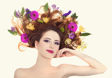 Beautiful redhead girl with flowers Royalty Free Stock Photo