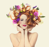 Beautiful redhead girl with flowers isolated Royalty Free Stock Photography