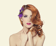 Beautiful redhead girl with flowers isolated Royalty Free Stock Images
