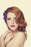 Beautiful redhead girl with flowers isolated Stock Image