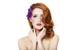 Beautiful redhead girl with flowers isolated Stock Photography