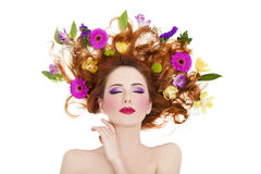 Beautiful redhead girl with flowers isolated Stock Photos