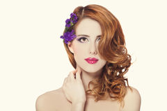 Beautiful redhead girl with flowers isolated Stock Photo