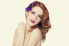 Beautiful redhead girl with flowers isolated Stock Images