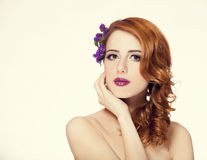 Beautiful redhead girl with flowers isolated Royalty Free Stock Image