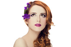 Beautiful redhead girl with flowers isolated Royalty Free Stock Photos