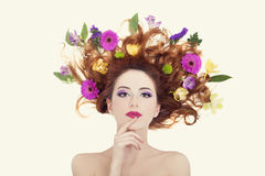 Beautiful redhead girl with flowers isolated. Stock Photos