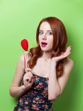Beautiful redhead girl with flowers Stock Image