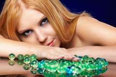 Beautiful redhead girl  with gel balls Royalty Free Stock Photos