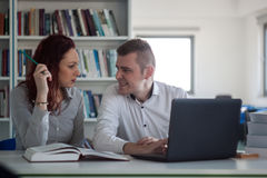 Beautiful redhead girl and handsome blond guy working on a proje Stock Photo