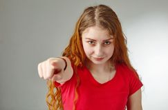 The beautiful redhead girl, pointing finger at camera. The beautiful redhead girl, having surprised shocked looks, pointing finger at camera Stock Photography