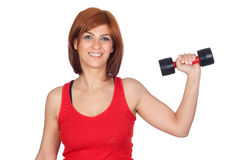 Beautiful redhead girl lifting weights Royalty Free Stock Image