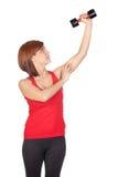 Beautiful redhead girl lifting weights Royalty Free Stock Photo