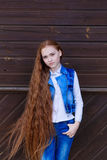 Beautiful redhead girl with long hair up to knees. Posing outdoors Royalty Free Stock Photos