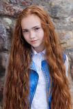 Beautiful redhead girl with long hair up to knees. Posing outdoors Royalty Free Stock Photography