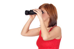 Beautiful redhead girl looking through binoculars Royalty Free Stock Photo