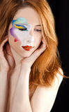 Beautiful redhead girl with make-up. Stock Photo