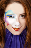 Beautiful redhead girl with make-up. Royalty Free Stock Photo