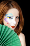 Beautiful redhead girl with make-up. Royalty Free Stock Images