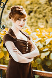 Beautiful redhead girl the park Royalty Free Stock Photography