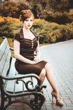 Beautiful redhead girl the park Stock Photo