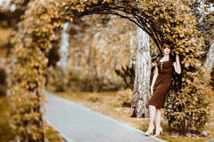 Beautiful redhead girl the park Royalty Free Stock Image