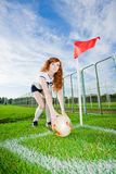 Beautiful redhead girl plays soccer Royalty Free Stock Photos