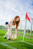 Beautiful redhead girl plays soccer Royalty Free Stock Images