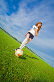Beautiful redhead girl plays soccer Royalty Free Stock Image
