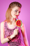 Beautiful redhead girl portrait with big lollipop Royalty Free Stock Photography