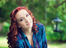 Beautiful redhead girl. Beautiful portrait of a redhead girl outdoors Stock Photos