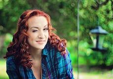 Beautiful redhead girl. Beautiful portrait of a redhead girl outdoors Royalty Free Stock Image