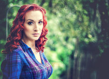 Beautiful redhead girl. Beautiful portrait of a redhead girl outdoors Royalty Free Stock Images