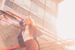 Beautiful redhead girl posing in an urban context Stock Images