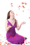 Beautiful redhead girl with rose petals Royalty Free Stock Image