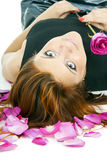 Beautiful redhead girl with rose petals Stock Images