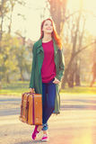 Beautiful redhead girl with suicase Stock Photos