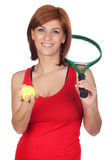 Beautiful redhead girl with a tennis racket Royalty Free Stock Image