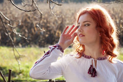 Beautiful redhead girl in Ukrainian clothes Stock Photos