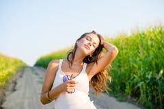 Beautiful redhead girl in white dress walking by Stock Image