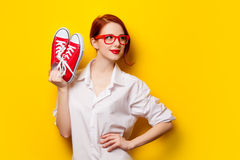 Beautiful redhead girl in white shirt with gumshoes Stock Photo