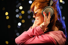 Beautiful redhead with headphones Royalty Free Stock Photos
