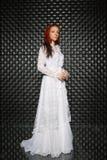 Beautiful redhead lady posing in studio stock photography