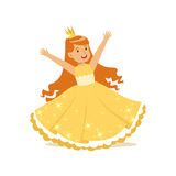 Beautiful redhead little girl princess in a gold ball dress and golden tiara, fairytale costume for party or holiday Royalty Free Stock Image