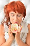 Close up portrait of beautiful redhead mature woman posing. Beautiful redhead mature woman posing with flower royalty free stock image