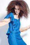 Beautiful redhead model posing in studio shot stock images