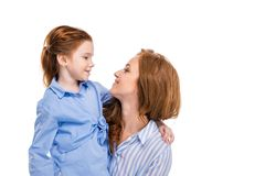 beautiful redhead mother and daughter smiling each other royalty free stock photo