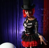 Beautiful redhead performer. Portrait on stage royalty free stock photos