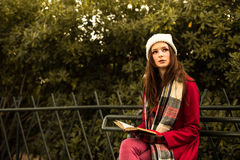 Beautiful Redhead reading a book Stock Photos