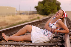 Beautiful Redhead Reclining on the Tracks Stock Photos